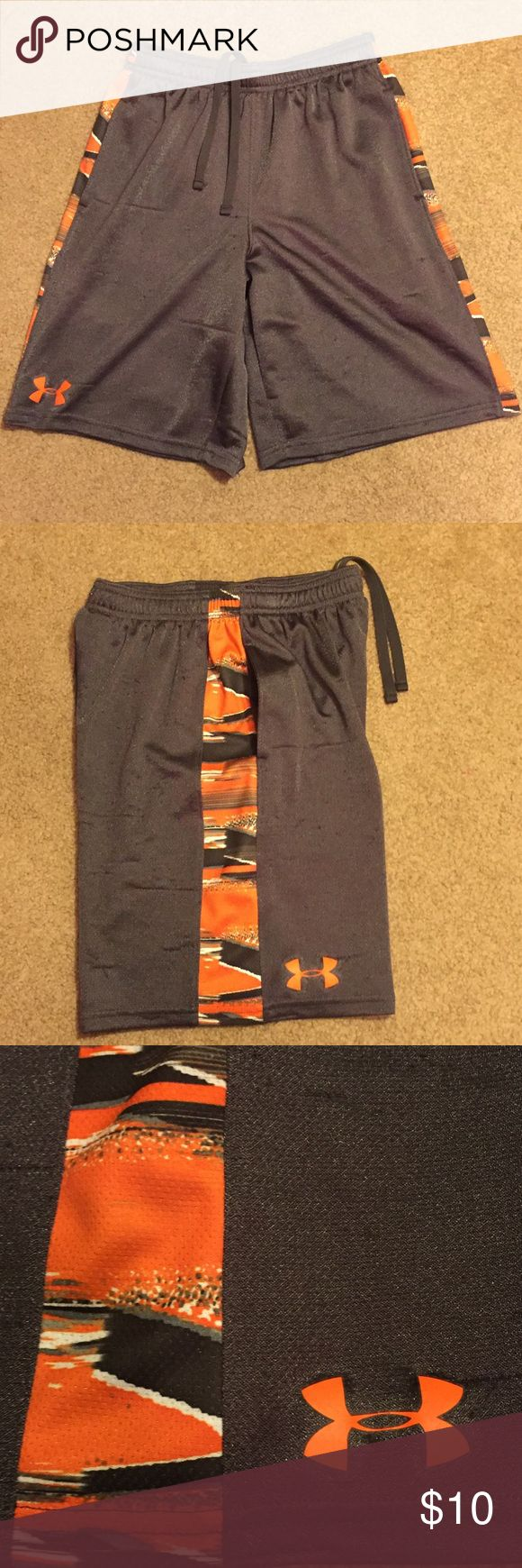 Boys youth medium under armour shorts. Boys youth medium shorts from under armor. Dark gray with orange black and gray pattern trim. Shorts have a lot of picks in the material and I would definitely consider them playclothes. I did my best to show The picks in the close-ups.  Waste of approximately 23 inches unstretched and have a drawstring to make smaller. Inseam measures approximately 9 inches. Under Armour Bottoms Shorts