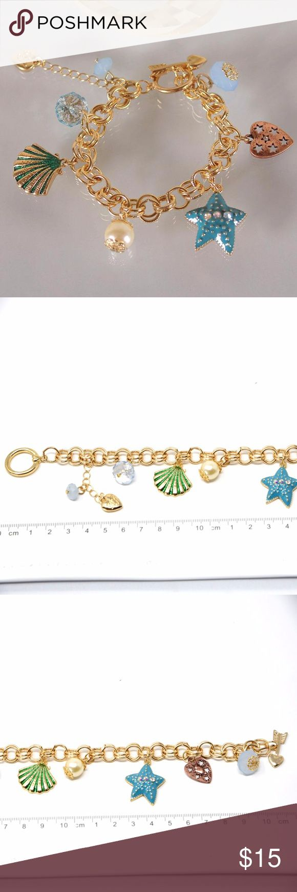 """Betsey Johnson Starfish Sea Shell Charm Bracelet This is a BRAND NEW Betsey Johnson bracelet with a starfish, a sea shell and a heart charms.  The length of the chain is 8"""".  I also have a beach ocean themed necklace for sale. Please check my other listings.  Bundle and save 15%. Betsey Johnson Jewelry Bracelets"""