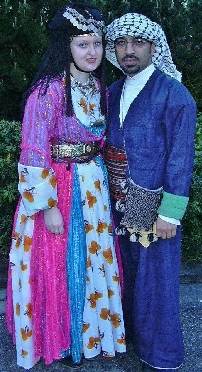 Traditional Kurdish costumes from the Hakkâri and Şirnak region. The man's costume is authentic (made in Şirnak in the 1960s), as are the accessories. The female costume is an accurate copy of the clothing in Yüksekova in the late 1980s; it was made (in the Kavak workshop) in 1990. Judging from the wedding video's on the internet, the fashion in Yüksekova has shifted to lighter and workshop-made costumes today. (Kavak Folklor Ekibi & Costume Collection-Antwerpen/Belgium).