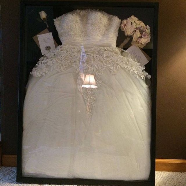 We love the idea of putting your wedding dress in a shadow for Wedding dress shadow box