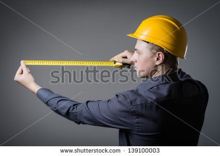 worker often with a measuring tape