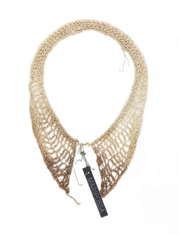 This necklace is made from fine handwoven silver and copper oxidised chains, creating a web like effect.