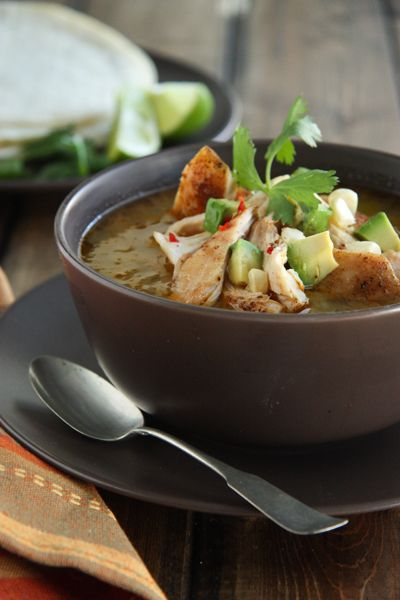 Chicken Tomatillo and Chile Soup - looks similar to CHICKEN POSOLE, but I would use hominy instead of corn.  Also, in addition to cilantro & avocado, garnishes would include shredded cabbage, sour cream, limes (to squeeze at table), and shredded cheese.  SO DELICIOUS!