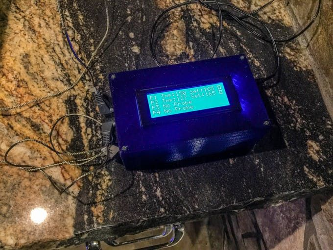 A BBQ thermometer with 4 separate probes. Control settings, monitor progress, and get notifications on your phone. By Rob Redford.