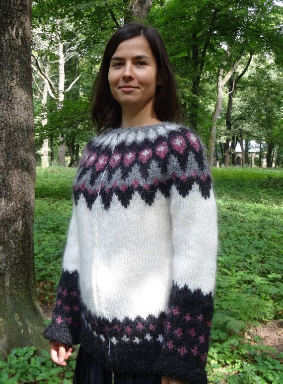 This is a beautiful traditional Icelandic sweater - a lopapeysa. The warm sweater is knit in natural yarn with the main colour being white with some