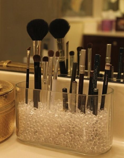 Great idea to make your makeup area cuter.Put brushes in a container with pebbles-stones