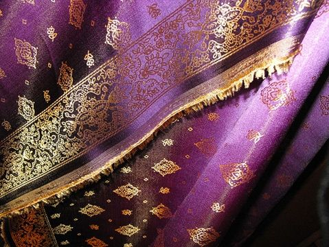 purple indian fabric with gold details