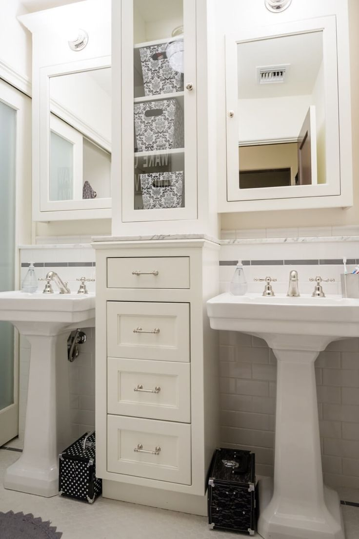 Double pedestal sinks with storage drawers in between for Bathroom decor and storage