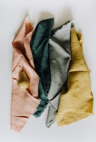 Made of pure linen and a simple design, these napkins have a frayed edge and a hand-sewn single buttonhole to protect your shirt, blouse or dress. The napkins come in a neatly tied stack of four in vi