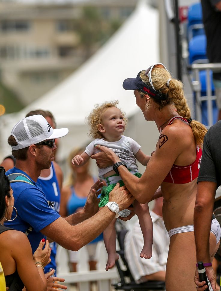 Kerri Walsh Jennings has so much to be proud of in this picture with her daughter, Scout and husband Casey Jennings!  This picture was taken after her win at the Asics World Series of Beach Volleyball.