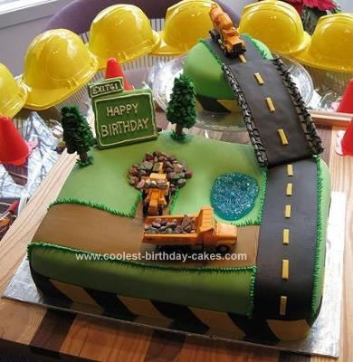 Homemade Construction Birthday Cake: This special construction birthday cake was created for my nephew's first birthday.  It is a two layer half sheet and a two layer 6-inch round white cake