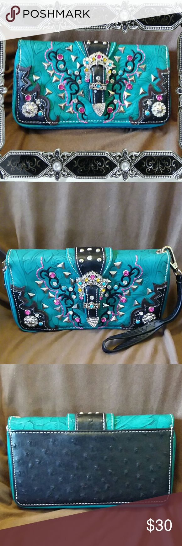 "Cowgirl trendy western wristlet zip wallet Cowgirl trendy western wristlet zip wallet,  turquoise.  High quality patterned leather exterior.  Fully lined fabric interior.  Floral motif with jeweled buckle,  conchos,  and faux gemstone studs. Detachable wrist strap.  Zipper around closure.  2 zip close interior compartments.  Dimension 7.5""L x 4.5""H x 1""W.  NWOT Bags Wallets"