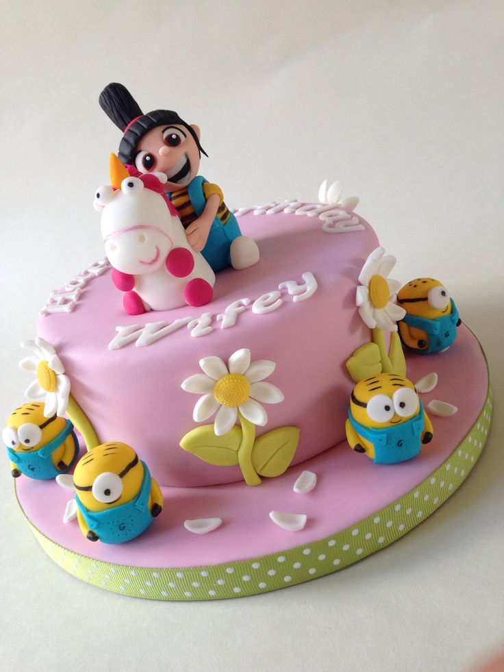 Despicable Me cake topped with Agnes and her Unicorn and surrounded with Minions