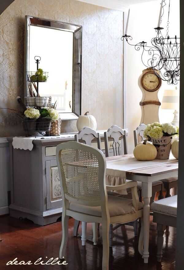 Shabby chic.  Wood top table with painted legs; 6 side chairs