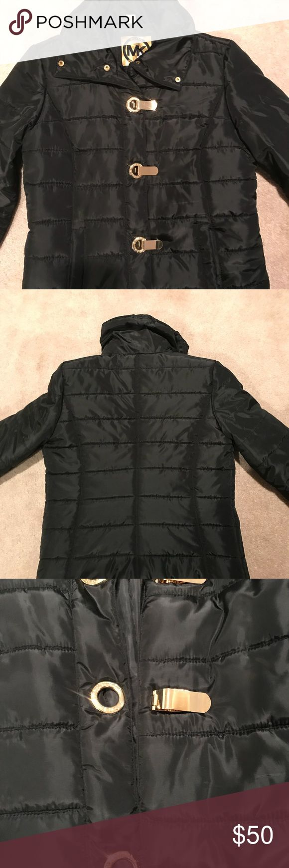 Michael Kors black small puffer coat Only worn a few times. Cozy light coat for winter with pretty gold hardware. Michael Kors Jackets & Coats Puffers