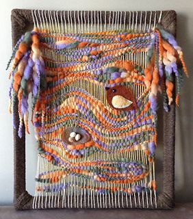 I did this weaving with a skein of yarn that I loved the colors. The little birdie invited himself in and made a nest. Then a koi got curious and came for a look.