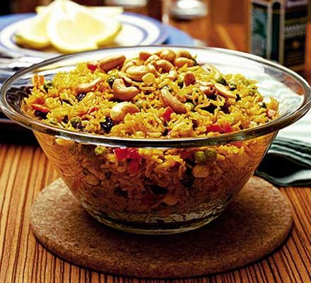 Boil the kettle. Put rice, veg and raisins in a microwave safe bowl. Pour in 600ml of boiled water in with the stock cube, then stir in curry paste. Cover the bowl in cling film leaving a small gap for steam. Cook on 850w for 12min or more for lower watts. Let stand at room temperature for 5min.  Fluff up before serving.