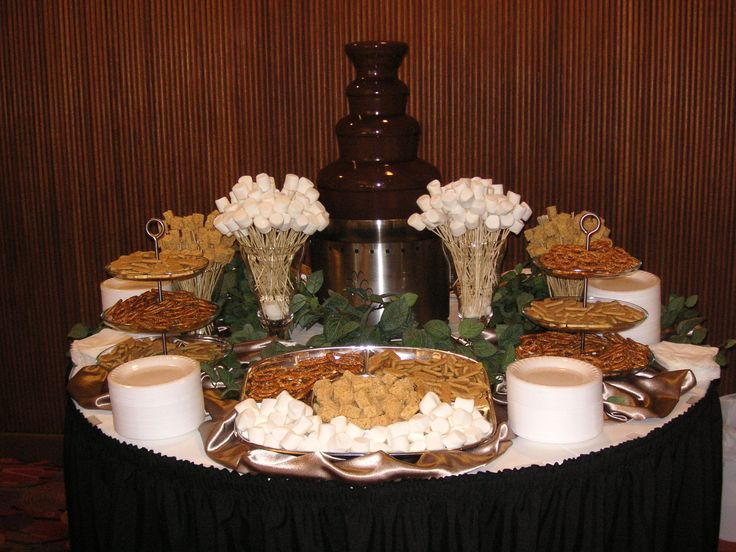 Chocolate Fondue Fountain with marshmallows, Rice Krispie Treats, pretzels and Graham Crackers.
