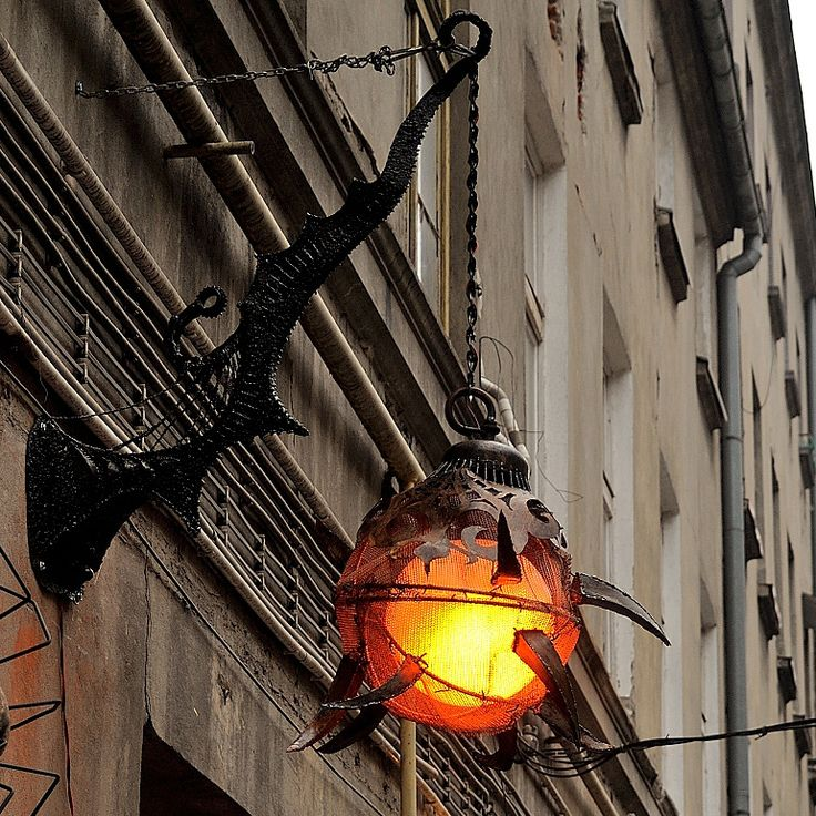 Metal lamp welded from scrap. Postapo fantasy lamp. Surindustrialle Gallery in Lodz / Poland. Scrap metal art, welding applied art and jewellery