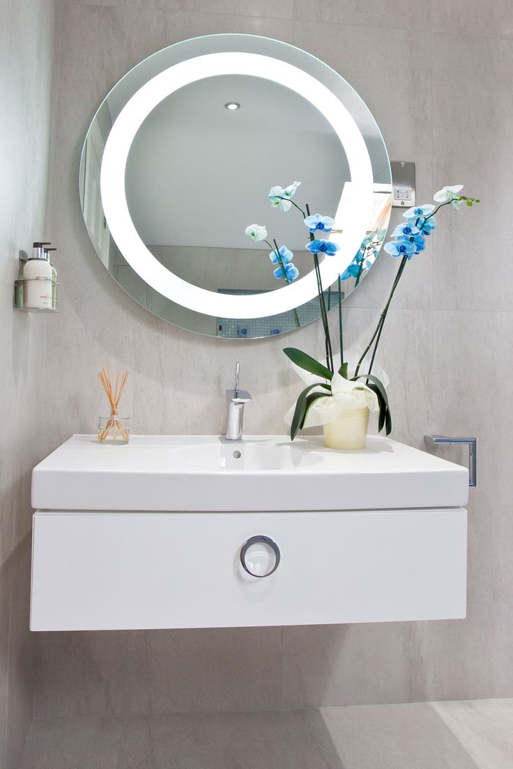 Mirror Art. Striking mirror doubles up as wall art and complements the chrome basin mixer. Copyright The Designer Knowledge. Photo by Ani Evans Photography.