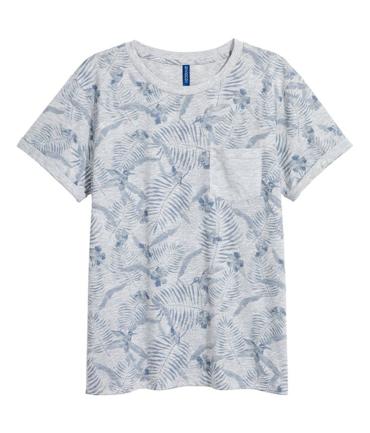 Check this out! T-shirt in printed cotton jersey with a chest pocket and sewn-in turn-ups on the sleeves. - Visit hm.com to see more.