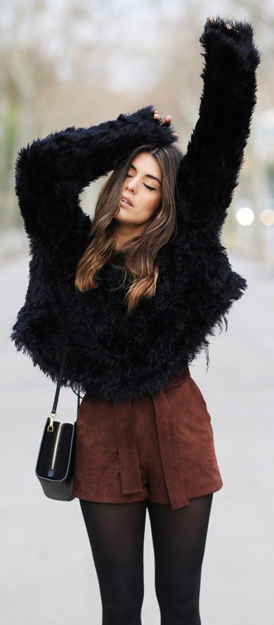 Aida Domenech is wearing a pair of Sammy Road suede shorts