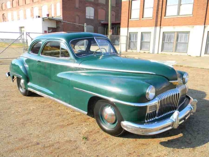 1948 DeSoto Custom. I had a 1946 4 door Custom. This looks a lot like it. Mine had a cast iron grill. A DeSoto was my first vehicle and I had a couple others. I liked the brand. WFH.
