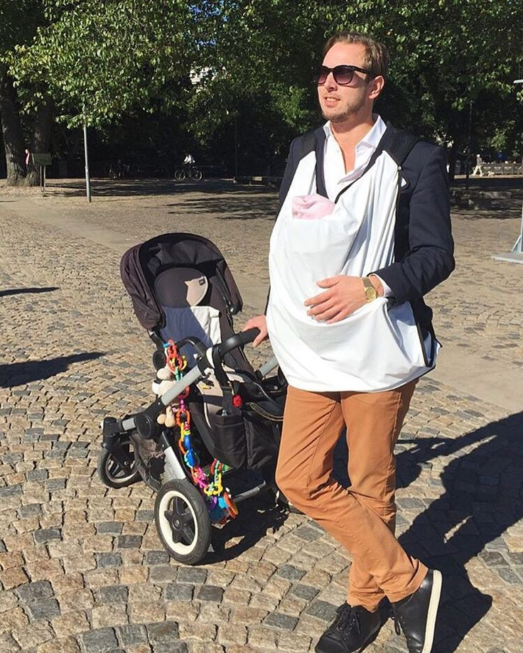 Stefan is trying out our Pēpē blanket designed to protect your baby from harmful sun rays. It's equipped with our smart press button system which makes it easy to fasten onto anything you like, anywhere you like. Shown here on a #babybjorn carrier. Soon available online.