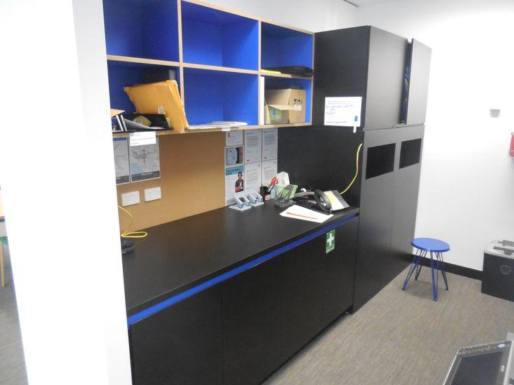 Utility room cabinetry using multiple veneers.
