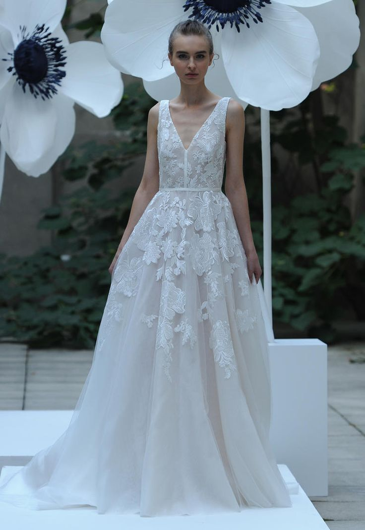 Lela Rose Fall 2016 sleeveless wedding dress with deep v neckline and floral embroidery | https://www.theknot.com/content/lela-rose-wedding-dresses-bridal-fashion-week-fall-2016