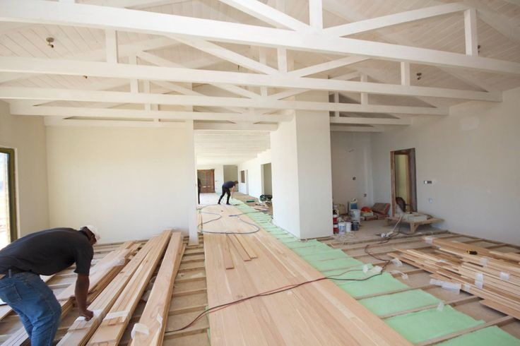 The dining room receiving its floors. We can't wait to have guests walking and dancing on these floors!