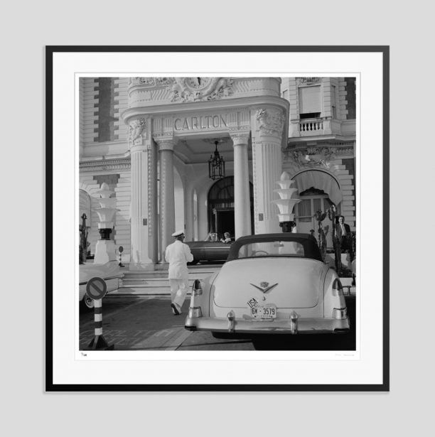 'The Carlton Hotel'      A Cadillac with Florida plates parked outside the Carlton Hotel, Cannes, France, circa 1955. (Photo by Slim Aarons)    Open Edition or Limited Edition Estate Stamped silver gelatin Print (edition size 1/150).  Various sizes and frames available from GALERIEPRINTS.com