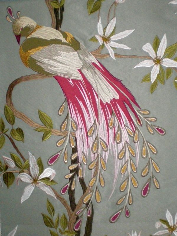 The Perroquet collection of wallpapers and fabrics from Nina Campbell, with prettily-painted birds.