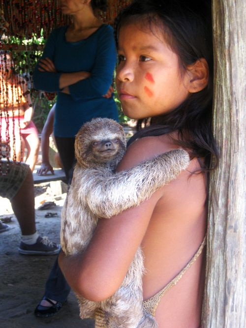 Yangua girl and sloth—The Amazon, Peru