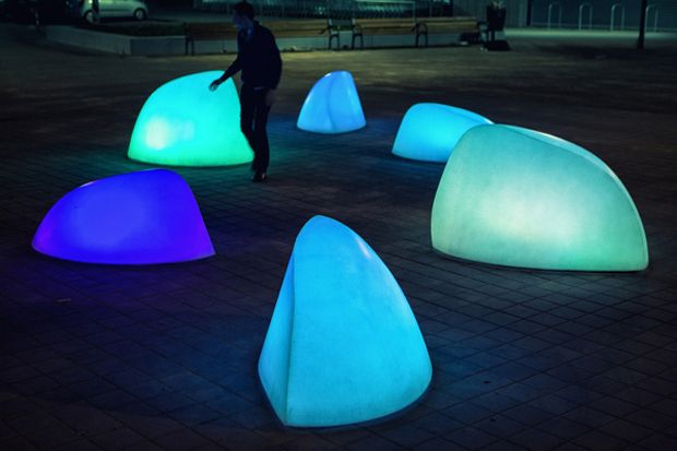 'Marbles', Stuido Roosegaarde's latest creation, is an interactive installation consisted of large glowing forms which interact with people via sound, light and color. Each 'Marble' with embedded sensor and interactive technologies is responsive to human presence. It also communicates with each other and transforms the square into an interactive environment of light and play.