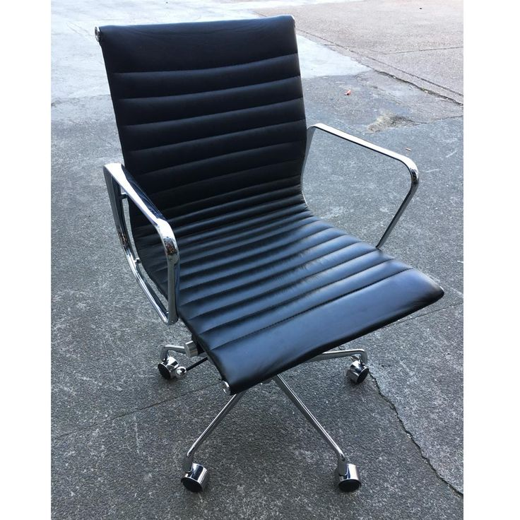Second Hand Eames Style Black Leather Office Chair | NEXT DAY DELIVERY | Inspired by Charles & Ray Eames' classic design, this used office chair has a ribbed leather upholstery with attractive contrasting chrome armrests & castor base, along with a host of features for comfort.