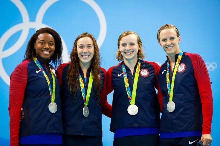 RIO DE JANEIRO, BRAZIL - AUGUST 06: Silver medalist Simone Manuel, Abbey Weitzeil, Dana Vollmer and Kate Ledecky of the United States pose during the medal ceremony for the Final of the Women's 4 x 100m Freestyle Relay on Day 1 of the Rio 2016 Olympic Games at the Olympic Aquatics Stadium on August 6, 2016 in Rio de Janeiro, Brazil. (Photo by Clive Rose/Getty Images)