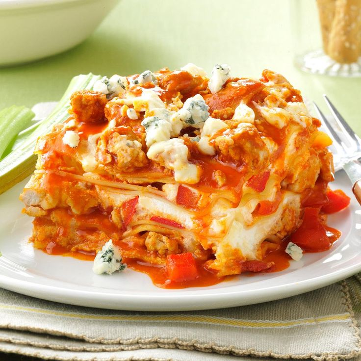 Slow Cooker Buffalo Chicken Lasagna Recipe -When I make this tasty chicken lasagna at home, I use a whole bottle of Buffalo wing sauce because my family likes it nice and spicy. Increase the pasta sauce and use less wing sauce if you prefer. —Heidi Pepin, Sykesville, Maryland