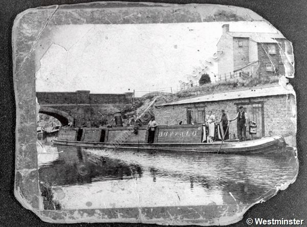 "Lock Bridge on the Grand Junction Canal viewed from the bank on the Clarendon Street side of the canal. Also shows the Stanton family on the canal boat ""Buffalo"" (1900)"