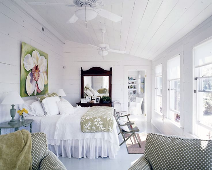 """Here are two photos from the """"Amazing Grace"""" feature in the March 2009 issue of Coastal Living magazine (taken by my gifted friend Richard Leo Johnson) which features a large orchid in the master bedroom and an oyster painting in the guest bedroom, and shows how her artwork helps to finish off a room."""