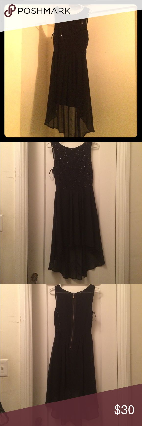 Black Sparkly Dress This is a beautiful well kept black dress. Can wear to any formal event or just a day at the beach. The size is a 9/10 B Darlin Dresses
