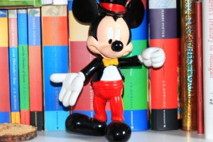 Mickey in front of books. More like this at; http://www.facebook.com/pages/anotherphoenixcom/263497840343197