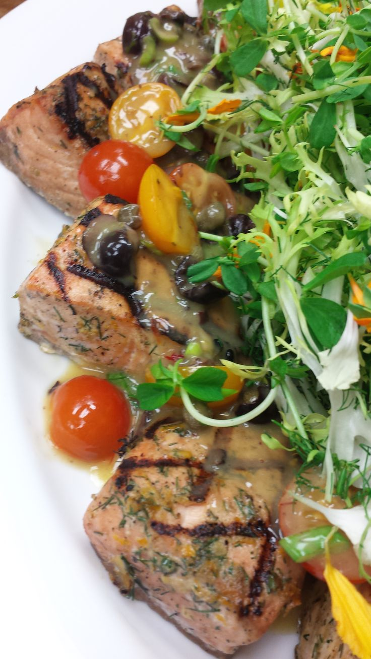 Grilled Mediterranean Salmon Fillet with Heirloom tomatoes, Nicoise Olives and Capers in  a pernod butter sauce....