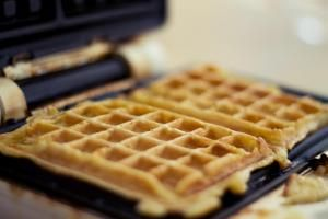 Waffle iron with fresh golden waffles - Kelly Sillaste/Moment/Getty Images