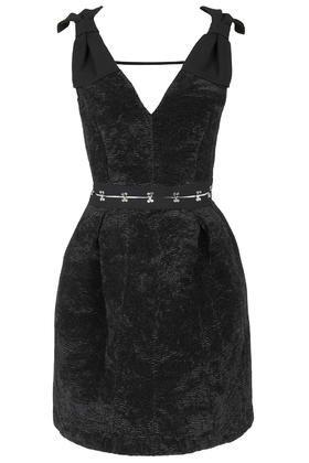 Mini robe avec nœud et œillets