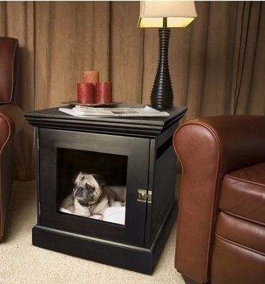 Well although this little chap doesn't look too impressed, I think it's a very stylish and versatile dog bed and lamp table rolled into one.... Now that's multi functional!