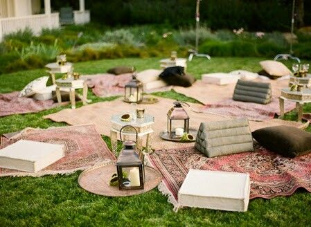 Chill zone. We will set something like this up on one of the olive terraces between the house and the marquee. We have bought 4 triangle cushions, two mini tray tables (white) and lanterns to scatter. Collecting rugs & cushions. as we go. Colours not pink though, the cushions are in another photo, and I have some light green, light blue, ivory coloured rugs.