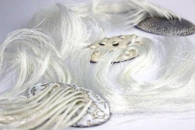 Mirka Janeckova, Hair Brooches  Series of three brooches inspired by Surrealism.  Silver, Enamel, Thread. - Glasgow School of Art - at New Designers 2013