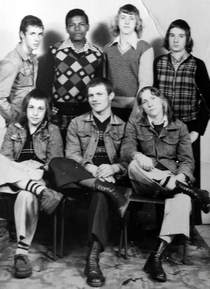"""In 1972, it was possible to be a """"boot boy"""" - wearing the boots and braces of the skinheads, but also sporting a feather cut long hair style. Boot boys were also frequently football hooligans."""