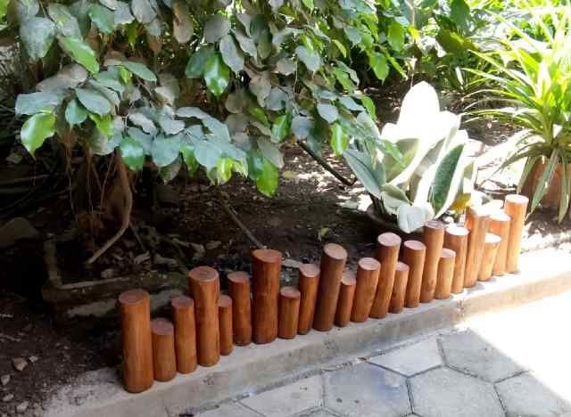 Unique teak log wood edging border for your garden from www.mastergardenproducts.com